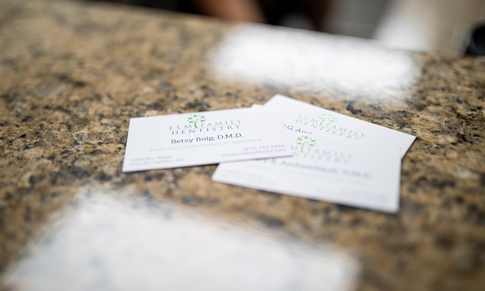 White business cards on the reception desk top